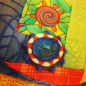 Glass button on patchwork